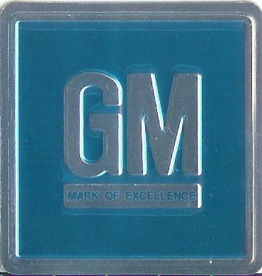 1967 G.M. Emblem W/ Teal Background